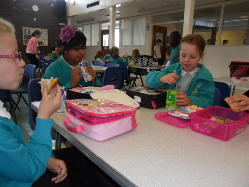 Children eating their lunch in the hall